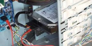 Installed 3.5-inch SATA hard disk drives showing the power and data cables attached to the drive and the data cable attached to the motherboard.